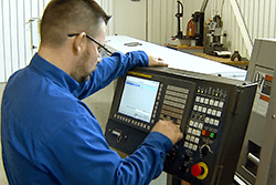 Techequip Engineer working at a console